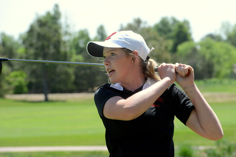 Loveland's Taylor Bandemer asks her drive to stay during Tuesday's second round of the 4A state girls golf tournament at Country Club of  Colorado in Colorado Springs. The freshman finished tied for fifth with a two-day total of 170. (Mike Brohard/Loveland Reporter-Herald)