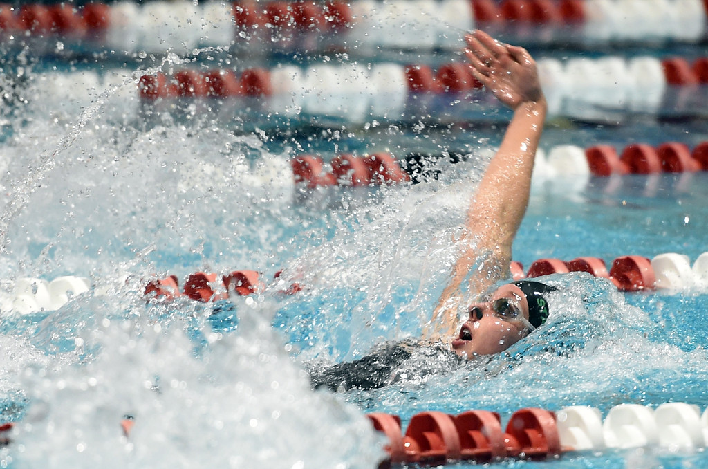 . Abigail Shaw, of Niwot, competes in the 100 yard backstroke at Colorado 4A Girls State Swimming in Thornton on Saturday.  For more photos, go to BoCoPreps.com.  Cliff Grassmick / Staff Photographer/ February 10, 2018