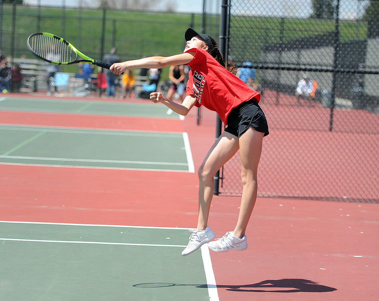 Tara Jeffries leaps into a serve during the 4A regional tournament at Centennial Park in Greeley on May 2, 2019. (Colin Barnard/Loveland Reporter-Herald)