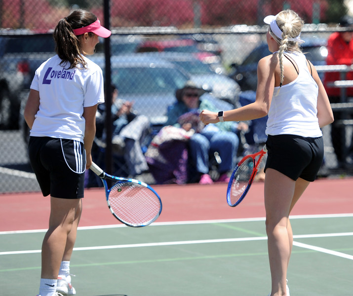 Ryley Williams, right, pumps her fist after winning a set with Emmalee Dekkers during the 4A regional tournament at Centennial Park in Greeley on May 2, 2019. (Colin Barnard/Loveland Reporter-Herald)