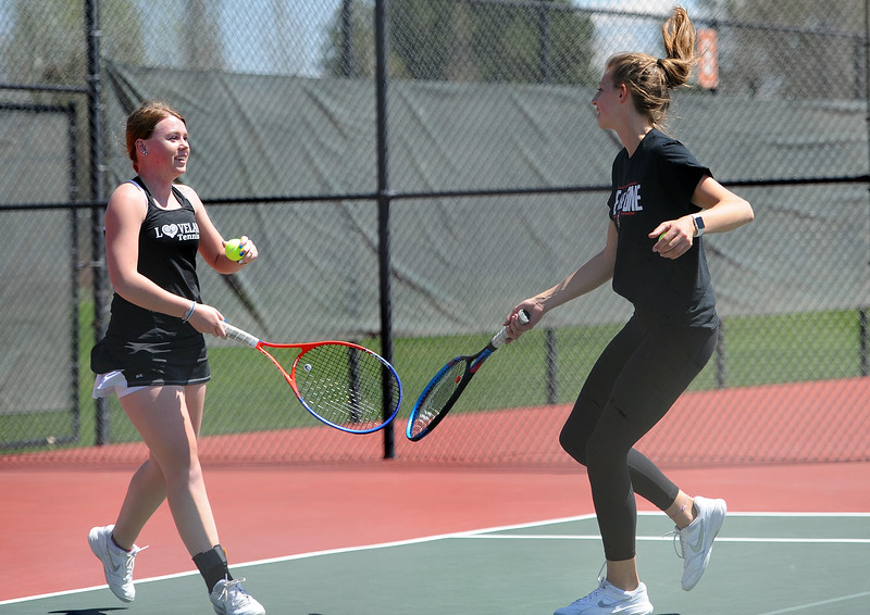 Jenna Dove, left, and Katie Kaufman celebrate a point during the 4A regional tournament at Centennial Park in Greeley on May 2, 2019. (Colin Barnard/Loveland Reporter-Herald)