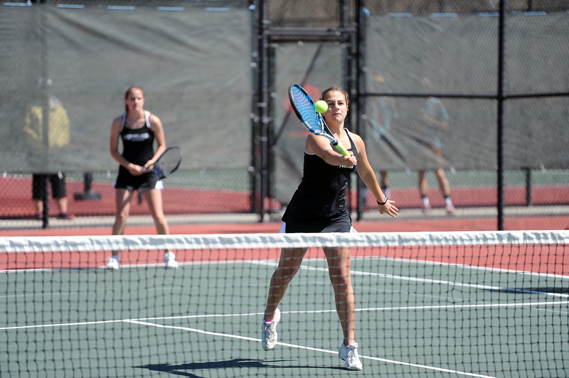 Emmy Barbattini hits a volley during the 4A regional tournament at Centennial Park in Greeley on May 2, 2019. (Colin Barnard/Loveland Reporter-Herald)