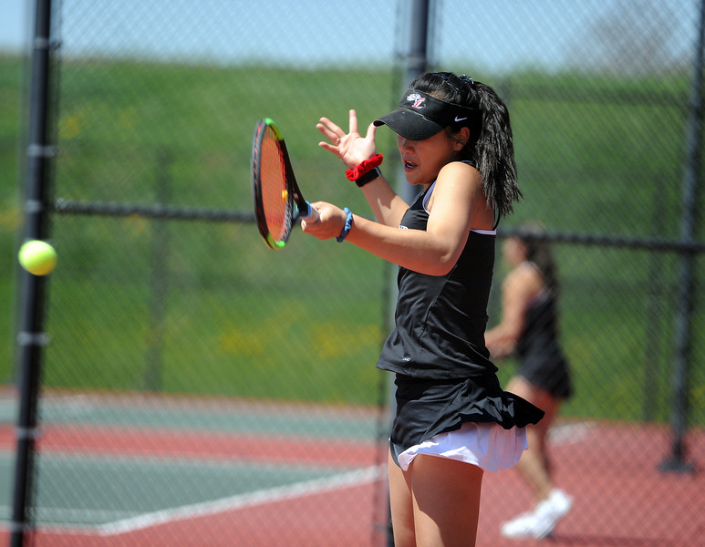 Beilynn Geiss connects with a forehand during the 4A regional tournament at Centennial Park in Greeley on May 2, 2019. (Colin Barnard/Loveland Reporter-Herald)