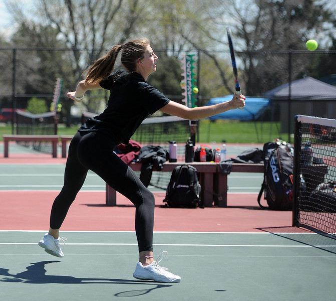 Katie Kaufman leans into a volley during the 4A regional tournament at Centennial Park in Greeley on May 2, 2019. (Colin Barnard/Loveland Reporter-Herald)