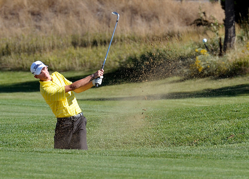 Thompson Valley's Nate Dwyer hits out of a sand trap during the 4A Northern Regional Golf Tournament on Monday, Sept. 19, 2016, at Boomerang Golf Links in Greeley. (Photo by Jenny Sparks/Loveland Reporter-Herald)