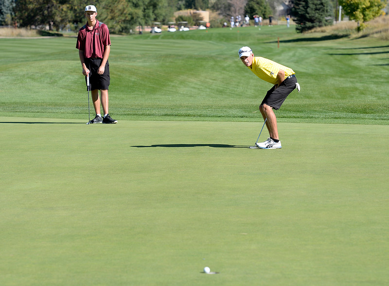 Thompson Valley's Nate Dwyer, right, almost sinks a putt as Berthoud's Josh Schumacher, left, watches his shot during the 4A Northern Regional Golf Tournament on Monday, Sept. 19, 2016, at Boomerang Golf Links in Greeley. (Photo by Jenny Sparks/Loveland Reporter-Herald)