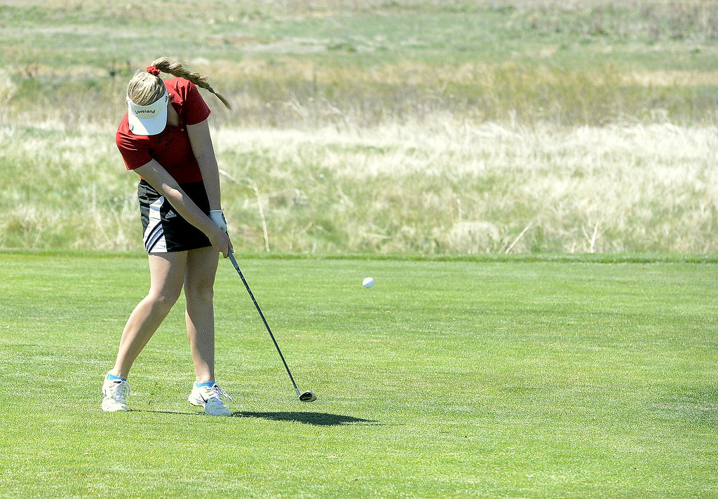 . Loveland\'s Aili Bundy hits an approach shot during Friday\'s 4A Region 4 golf tournament at Murphy Creek Golf Course in Aurora. The senior shot a 2-over 74 on the day to earn top medalist honors and help the Indians win the team title.