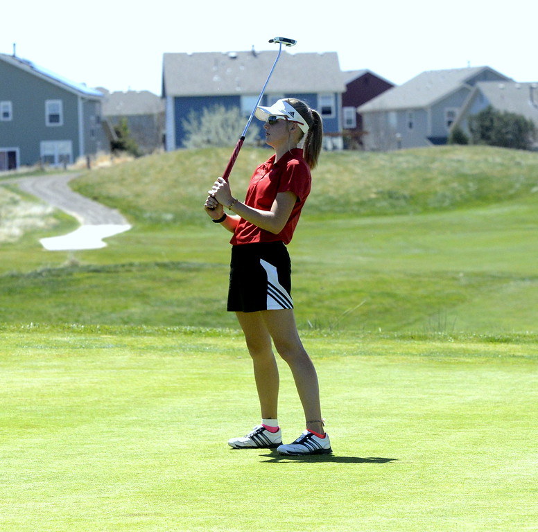 . Lovleand sophomore Lauren Lehigh reacts as her putt slid past the hole during Friday\'s 4A Region 4 golf tournament. Lehigh took second with a 3-over round of 75 at Murphy Creek Golf Course in Aurora.
