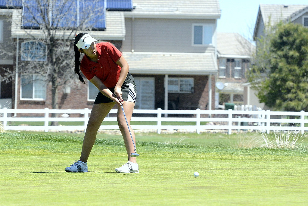 . Loveland\'s Natalee Hall watches the path of her putt during Friday\'s 4A Region 4 golf tournament at Murphy Creek Golf Course in Aurora. She shot a 94, qualifying her for state as an individual. The Indians also won the team title with a score of 235.