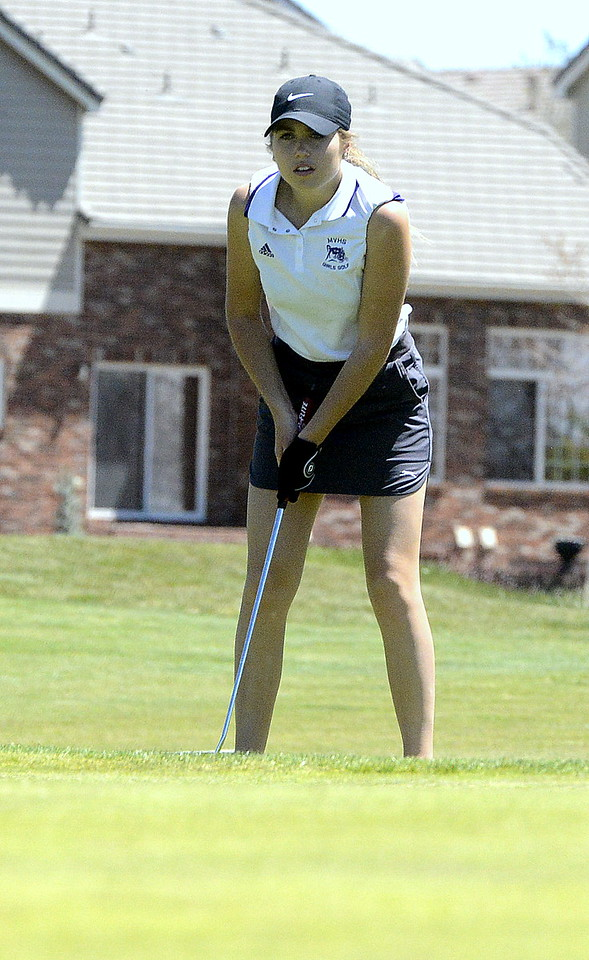 Mountain View's Renee Demaree gauges the break of the green as she looks over a putt during the 4A Region 4 golf tournament Friday at Murphy Creek Golf Course in Aurora. The junior earned a state berth with her round of 96.