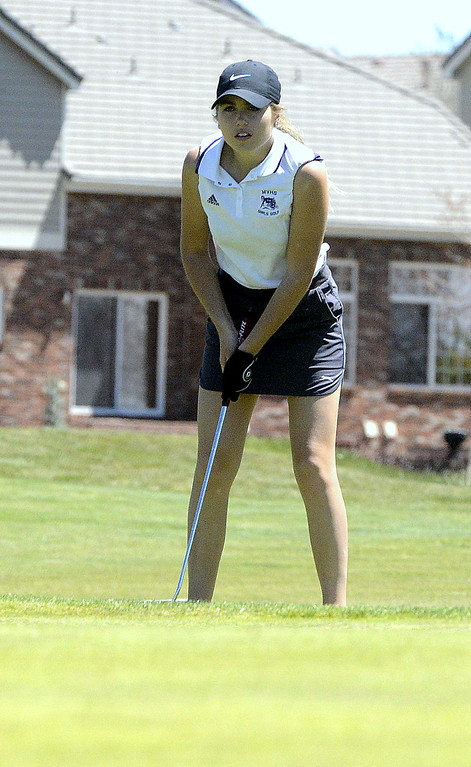 . Mountain View\'s Renee Demaree gauges the break of the green as she looks over a putt during the 4A Region 4 golf tournament Friday at Murphy Creek Golf Course in Aurora. The junior earned a state berth with her round of 96.