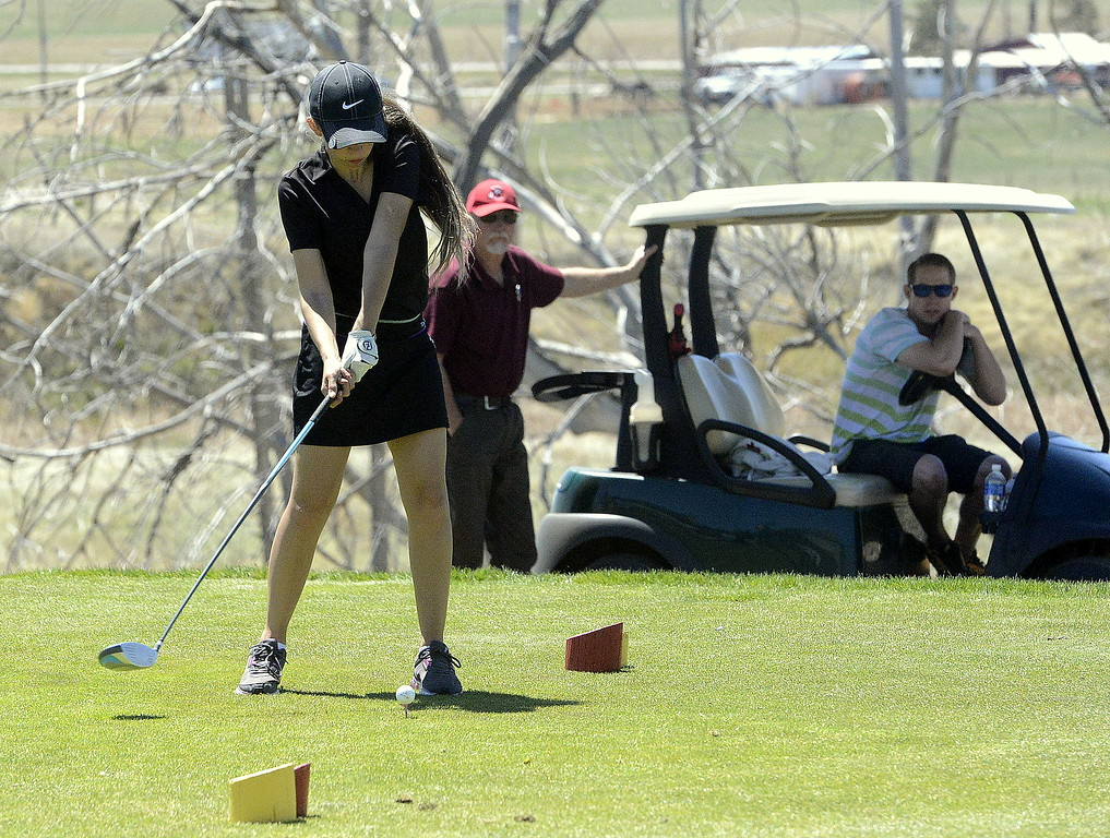 . Thompson Valley\'s Ryanna Burton comes through on her drive during Frdiay\'s 4A Region 4 golf tournament at Murphy Creek Golf Course. She was the only Eagle to compete on the day.