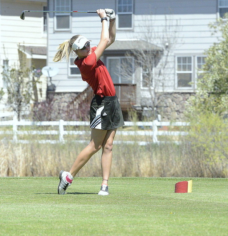 . Loveland\'s Lauren Lehigh follows the flight of her tee shot during Friday\'s 4A Region 4 golf tournament at Murphy Creek Golf Course in Aurora.