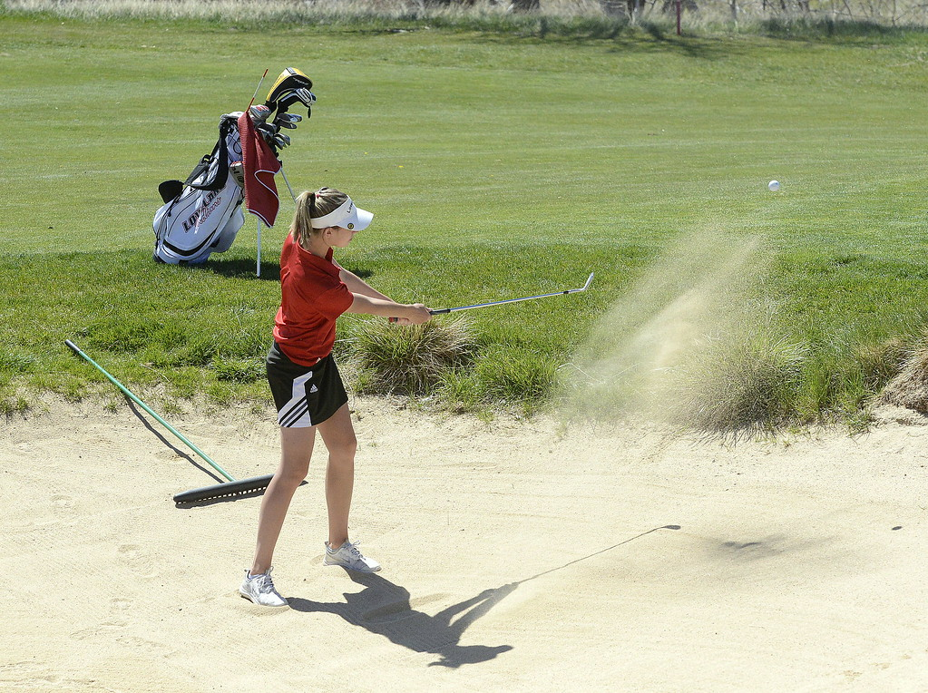 . Loveland\'s Hanna Doran gets out of a green-side bunker during Friday\'s 4A Region 4 golf tournament. The senior shot an 86 to finish fifth overall, helping the Indians win the team title.