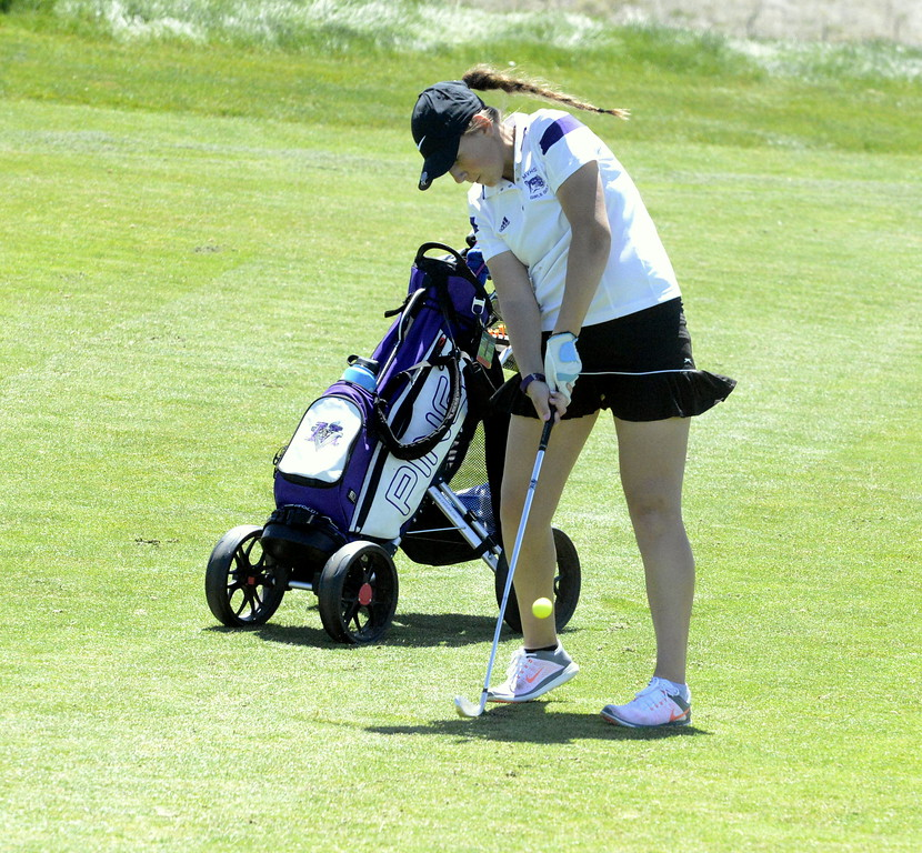 Mountain View's Katie Haag hits an approach shot during the 4A Region 4 golf tournament Friday at Murphy Creek Golf Course. She shot a 102 to make the cut for the state tournament.