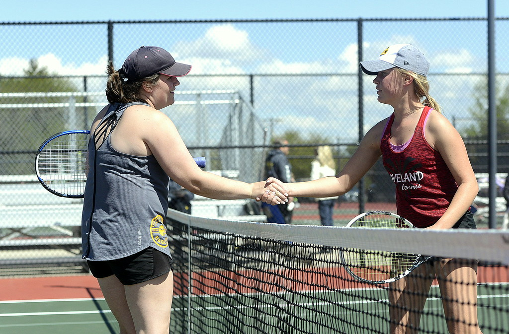 . Thompson Valley\'s Lyndsey Bauer, left, shakes hands with Loveland\'s Grace Haenny after winning their 4A Region 4 No. 3 singles semifinal 3-6, 6-3, 6-2 at Centennial Park in Greeley on Wednesday. The top five spots in the Eagles\' lineup reached the championship match.