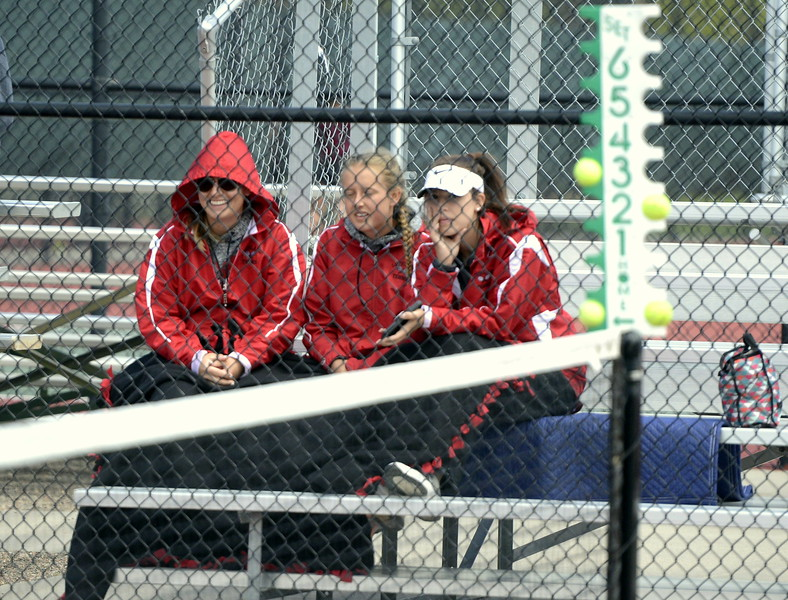 Members of Loveland's tennis team cheer on teammate Grace Haenny while trying to stay warm on Wednesday afternoon at Greeley's Centennial Park.