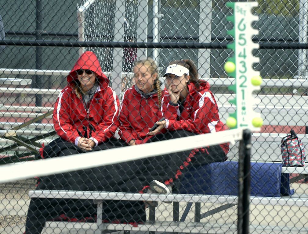 . Members of Loveland\'s tennis team cheer on teammate Grace Haenny while trying to stay warm on Wednesday afternoon at Greeley\'s Centennial Park.