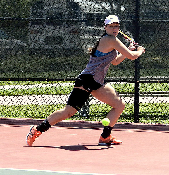 Ashlen Mickelson sets up her backhand return during the No. 1 singles Region 4 final in Greeley on Thursday. The Thompson Valley senior took second, but still earned a state berth.