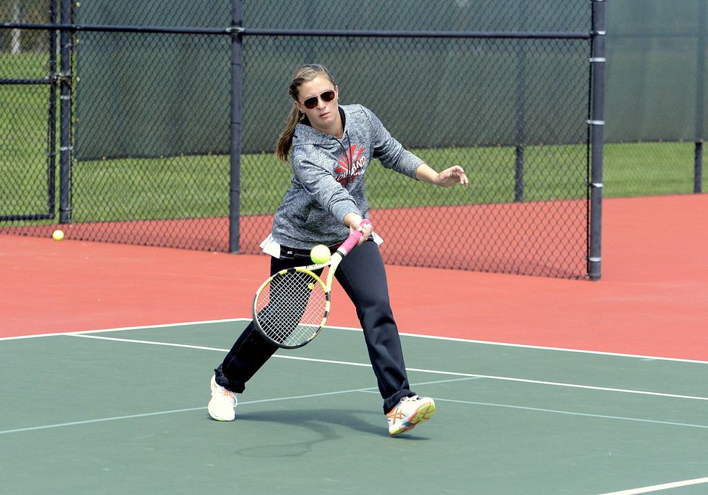 . Loveland\'s Addi Woodard returns a shot in her 4A Region 4 semifinal match at No. 2 singles with Greeley Wes\'t Lily Brytenson on Wednesday at Centennial Park in Greeley. Woodard reached the final with a 6-1, 6-4 victory and will face Thompson Valley\'s Maddie Sheets.