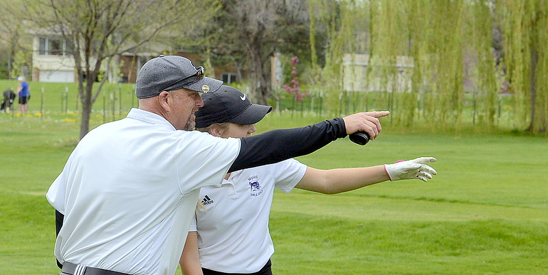 Mountain View coach Dave Hunn and Renee Demaree make sure they're in agreement as to the direction of her next shot during the 4A Region 4 golf tournament Monday at Highland Hills Golf Course in Greeley. (Mike Brohard/Loveland Reporter-Herald)