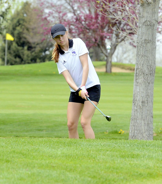 Isabella Romaro of Mountain View chips onto the green during the 4A Region 4 golf tournament Monday at Highland Hills Golf Course in Greeley. (Mike Brohard/Loveland Reporter-Herald)