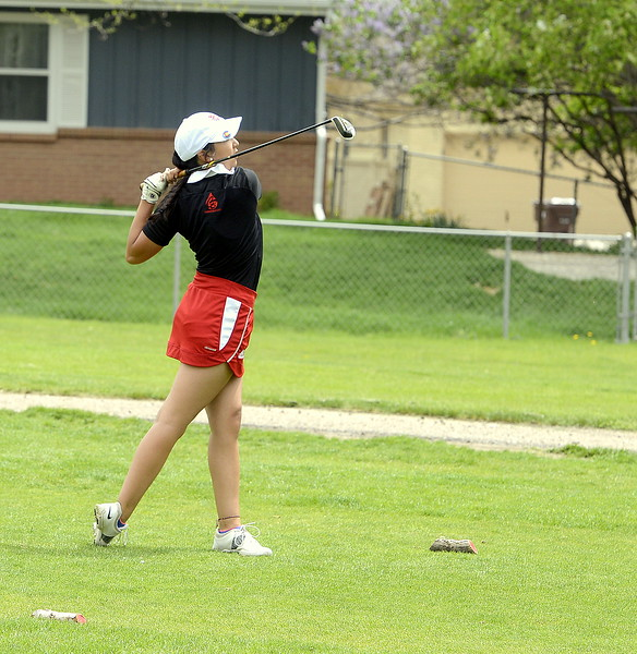 Loveland's Natalee Hall pulls out an iron for a drive during the 4A Region 4 golf tournament Monday at Highland Hills Golf Course in Greeley. (Mike Brohard/Loveland Reporter-Herald)