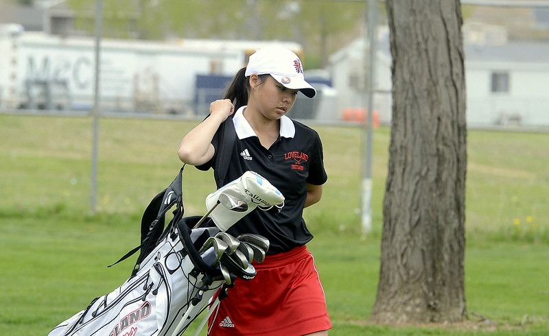 Loveland's Casey Bradley grabs her clubs and heads to her next shot during the 4A Region 4 golf tournament Monday at Highland Hills Golf Course in Greeley. (Mike Brohard/Loveland Reporter-Herald)