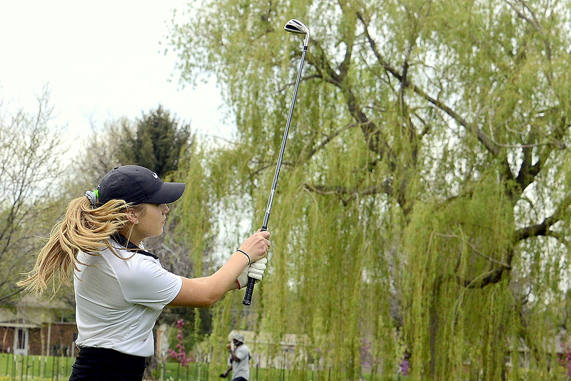 Renee Demaree watches her shot fly to the green during the 4A Region 4 golf tournament Monday at Highland Hills Golf Course in Greeley. (Mike Brohard/Loveland Reporter-Herald)