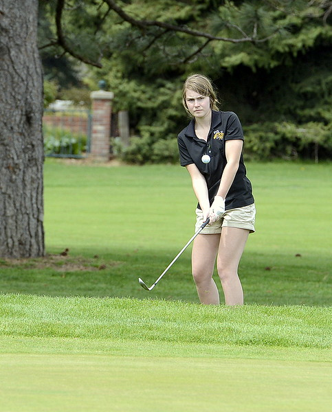 Thompson Valley's Megan Danielson chips onto the 13th green during the 4A Region 4 golf tournament Monday at Highland Hills Golf Course in Greeley. (Mike Brohard/Loveland Reporter-Herald)