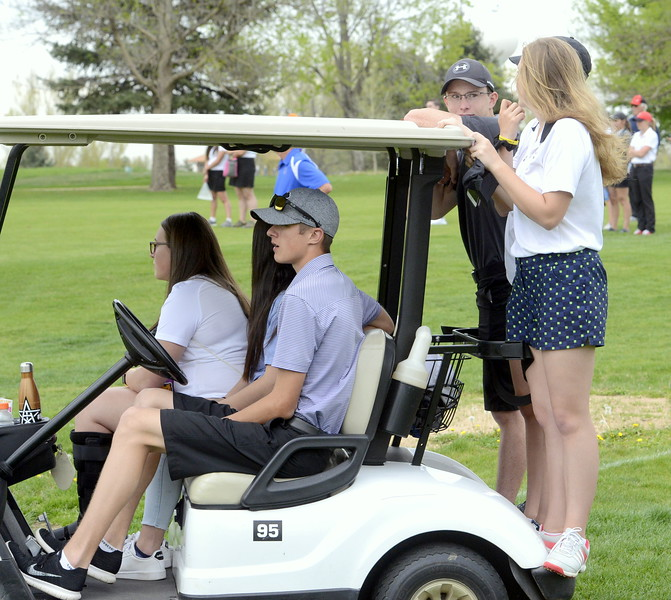 The cheering section for Mountain View's Camryn Polanksy loads up on a cart as they watch her compete in a playoff during the 4A Region 4 golf tournament Monday at Highland Hills Golf Course in Greeley.  (Mike Brohard/Loveland Reporter-Herald)