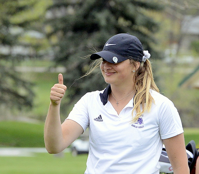 Mountain View's Camryn Polansky gives the thumbs-up sign after reaching the green from the fairway during the 4A Region 4 golf tournament Monday at Highland Hills Golf Course in Greeley. (Mike Brohard/Loveland Reporter-Herald)