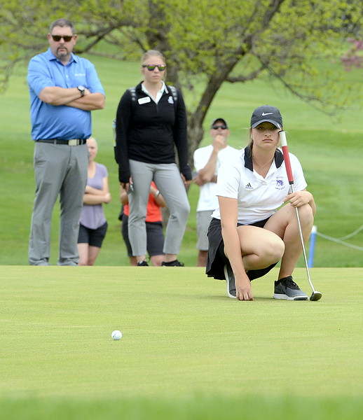 Mountain View's Camryn Polansky watches the roll of an opponent;s putt in a playoff during the 4A Region 4 golf tournament Monday at Highland Hills Golf Course in Greeley.  (Mike Brohard/Loveland Reporter-Herald)