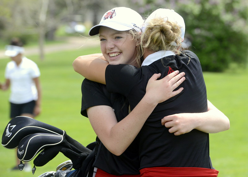 Loveland's Taylor Bandemer gets a hug from teammate Lauren Lehigh after finishing her round during the 4A Region 4 golf tournament Monday at Highland Hills Golf Course in Greeley. The Indians repeated as regional champions as each individual qualified for state. (Mike Brohard/Loveland Reporter-Herald)