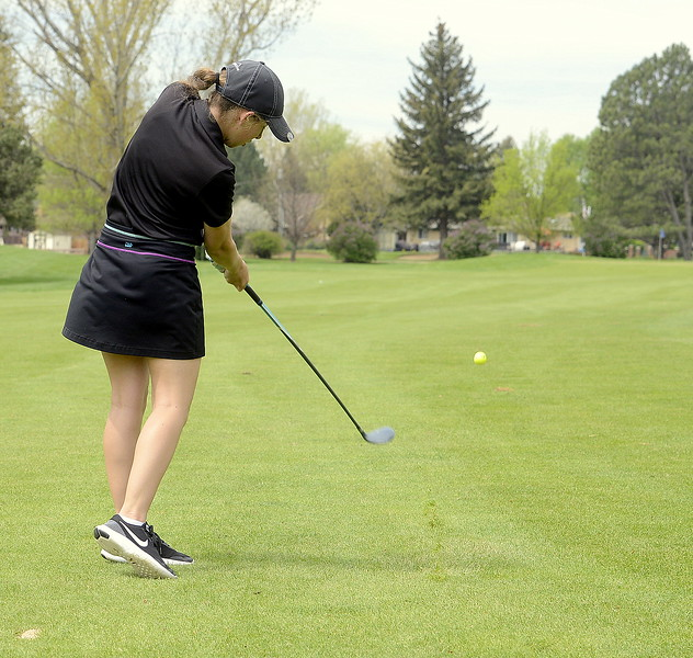 Thompson Valley's Ryanna Burton hits a fairway wood during the 4A Region 4 golf tournament Monday at Highland Hills Golf Course in Greeley. (Mike Brohard/Loveland Reporter-Herald)