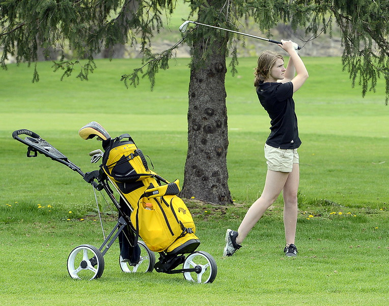 Thompson Valley's Megan Danielson goes for the green during the 4A Region 4 golf tournament Monday at Highland Hills Golf Course in Greeley. (Mike Brohard/Loveland Reporter-Herald)