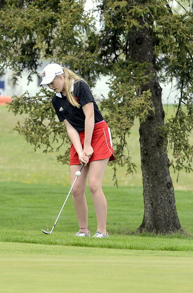 Loveland's Taylor Bandemer chips onto the green during the 4A Region 4 golf tournament Monday at Highland Hills Golf Course in Greeley. (Mike Brohard/Loveland Reporter-Herald)