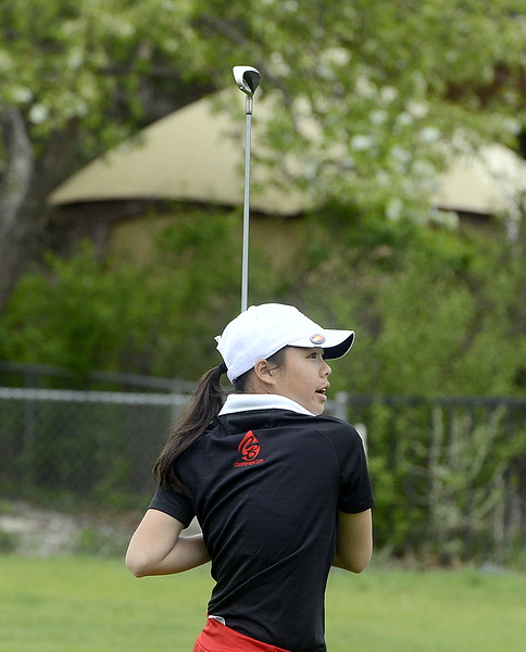 Casey Bradley of Loveland watches the flight of her drive during the 4A Region 4 golf tournament Monday at Highland Hills Golf Course in Greeley. (Mike Brohard/Loveland Reporter-Herald)