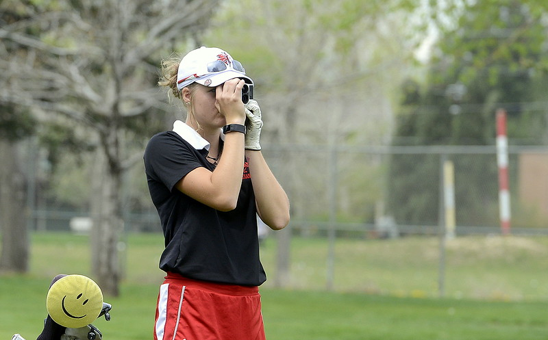Loveland's Lauren Lehigh checks the yardage on her next shot during the 4A Region 4 golf tournament Monday at Highland Hills Golf Course in Greeley. (Mike Brohard/Loveland Reporter-Herald)