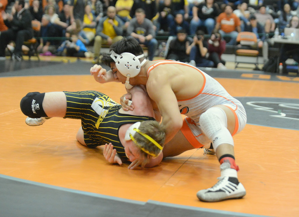 . Thompson Valley\'s Jay McLaughlin tries to fight his way out of the hold of Greeley Central\'s Andrew Alirez in their 152-pound championship match at Saturday\'s 4A Region 4 wrestling tournament at Mead. Alirez, ranked No. 1 nationally, won by fall. (Mike Brohard/Loveland Reporter-Herald)