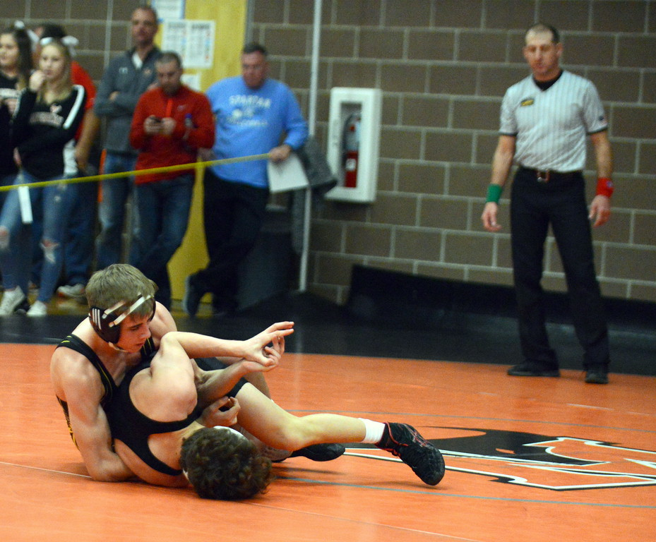 . Airiel Siegel of Thompson Valley looks to gain control in his 10-8 loss to Ethan Hays of Roosevelt in the 120-pound third-place match at Saturday\'s 4A Region 4 wrestling tournament at Mead. (Mike Brohard/Loveland Reporter-Herald)
