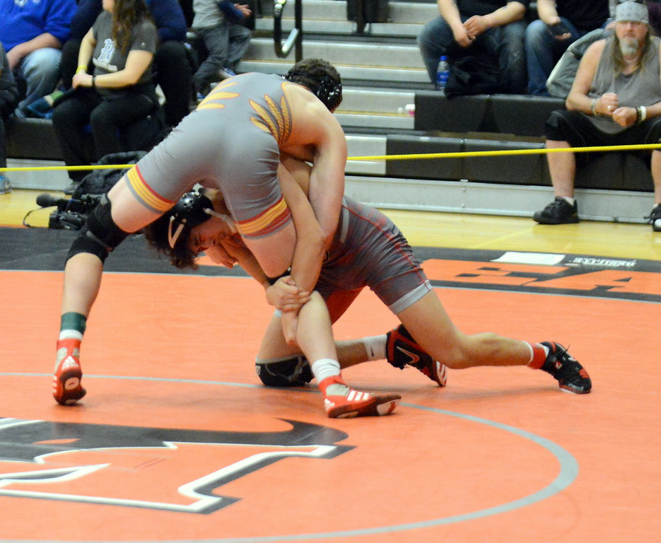 . Loveland\'s Marcelo Espinoza-Diaz goes for a single-leg takedown in his third-place match at 170 pounds with Creighton Trembly of Skyline. Espinoza-Diaz eventually won by fall, at Saturday\'s 4A Region 4 wrestling tournament at Mead. (Mike Brohard/Loveland Reporter-Herald)