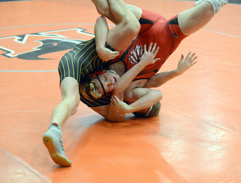Cody Donovan of Loveland and Thompson Valley's Trent Suppus get tangled up in a scramble in Donovan's 6-0 win in the third-place match at 145 pounds at Saturday's 4A Region 4 wrestling tournament at Mead. (Mike Brohard/Loveland Reporter-Herald)