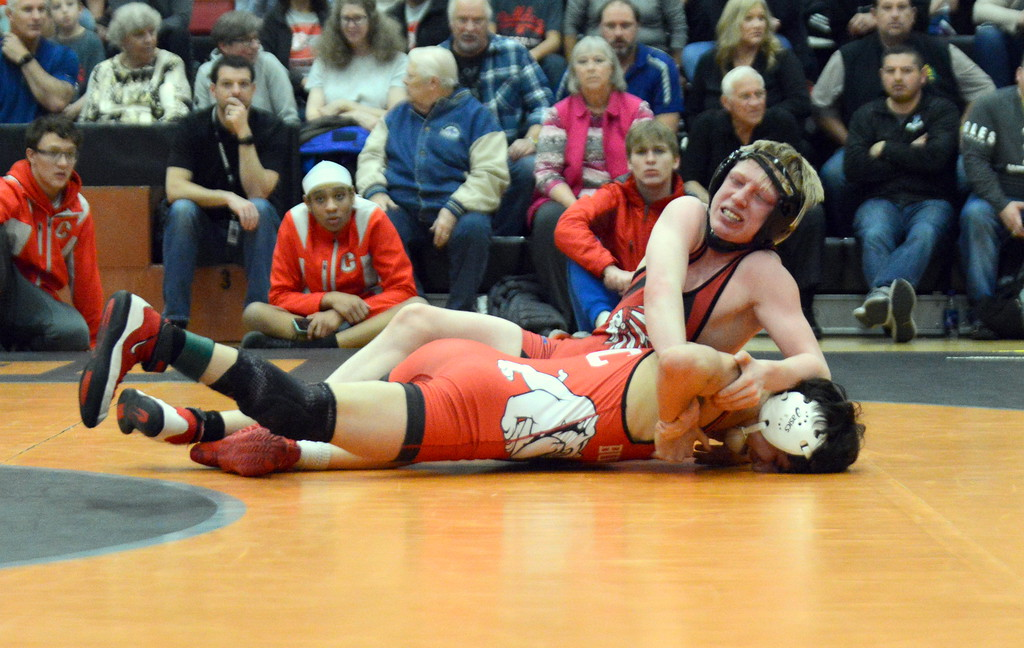 . Loveland\'s Kobi Johnson tries to turn Dominick Castro of Pueblo Centennial at the end of their 106-pound championship match at Saturday\'s 4A Region 4 wrestling tournament at Mead. Johnson lost a 4-3 decision. (Mike Brohard/Loveland Reporter-Herald)