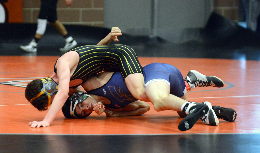 . Kameron Hanel looks for backpoints on his way to pinning Frederick\'s Cruz Jiminez ini their 113-pound fifth-place match at Saturday\'s 4A Region 4 wrestling tournament at Mead. (Mike Brohard/Loveland Reporter-Herald)