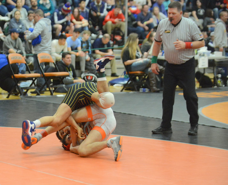Thompson Valley's Johnathan Walker comes out on top of a scramble with Greeley Central's Zander Alirez in his 7-2 victory in the third-place match at 138 pounds at Saturday's 4A Region 4 wrestling tournament at Mead. (Mike Brohard/Loveland Reporter-Herald)