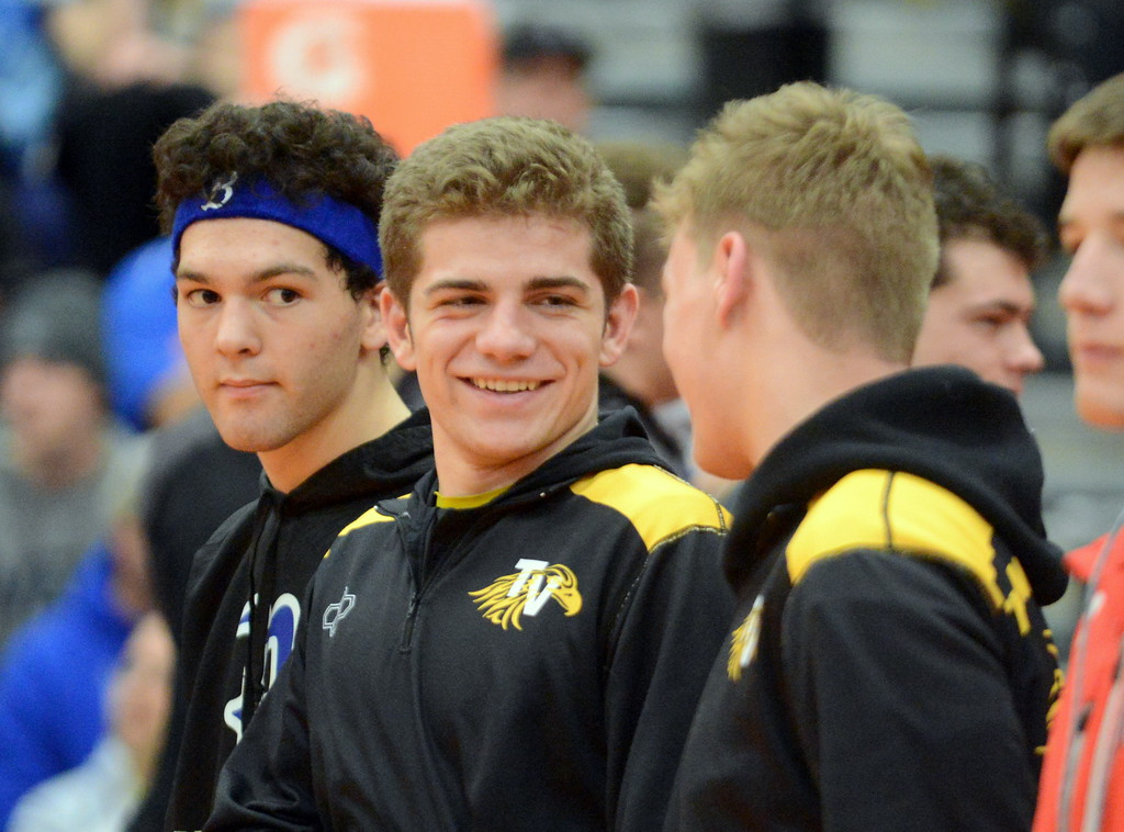. Thompson Valley 160-pounder Chase Engelhardt (center) talks with teammate Jay McLaughlin as wrestlers in the placement matches of the 4A Region 4 tournament are announced Saturday at Mead. (Mike Brohard/Loveland Reporter-Herald)