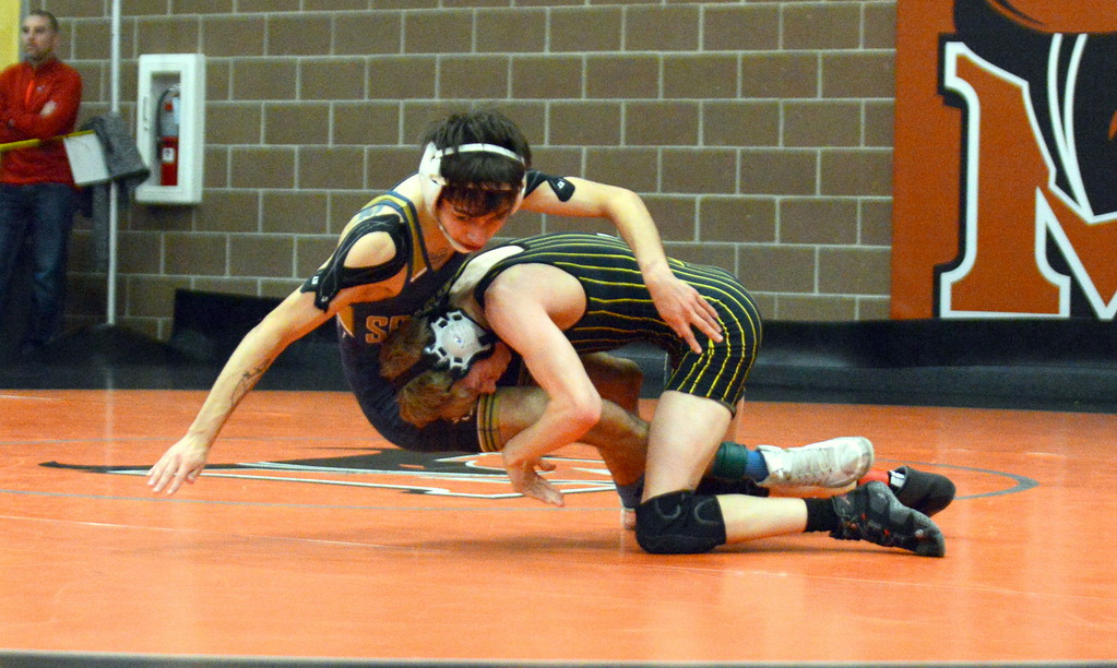 . Logan McCrimmon of Thompson Valley takes down Diono Velasquez of Greeley West in their 106-pound third-place match at Saturday\'s 4A Region 4 wrestling tournament at Mead. McCrimmon won an 8-6 decision. (Mike Brohard/Loveland Reporter-Herald)