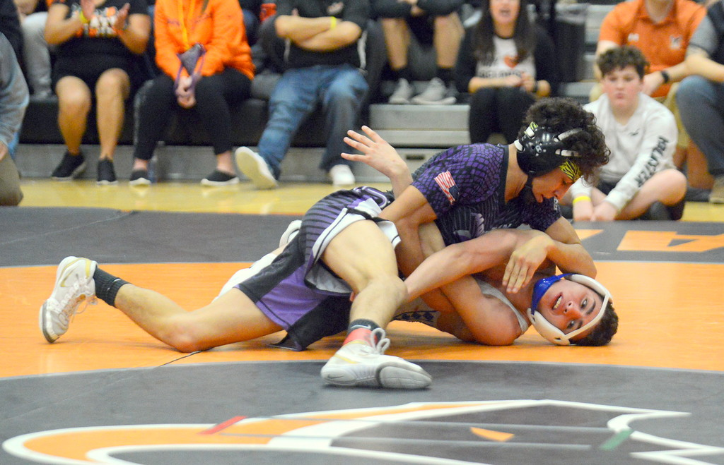 . Malachi Contreras of Mountain View puts Broomfield\'s Presley Madril on his way to a 10-3 win in the 120-pound championship match at Saturday\'s 4A Region 4 wrestling tournament at Mead. (Mike Brohard/Loveland Reporter-Herald)