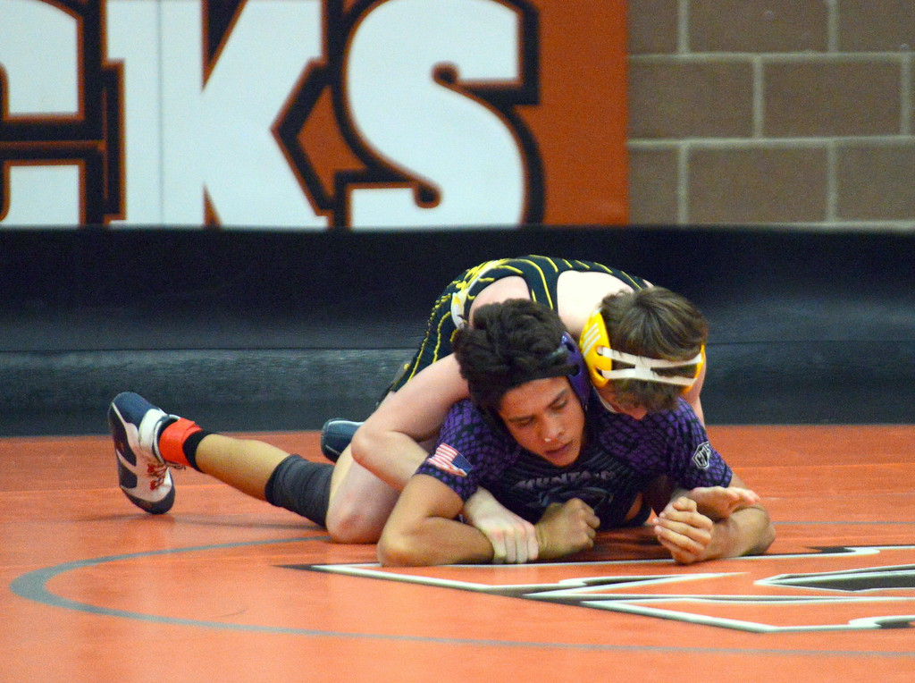 . Thompson Valley\'s Jacob Bierman (top) works his way to a 14-0 major decision of Mountain View\'s Mason Vigil in the 126-pound fifth-place match at Saturday\'s 4A Region 4 wrestling tournament at Mead. (Mike Brohard/Loveland Reporter-Herald)
